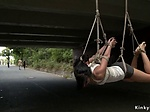 Hottie suspended from a bridge in public