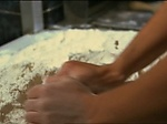 He fucks her while she makes bread ...