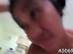 Thai slut plays with a schlong