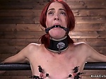Shackled redhead in pile driver gets toyed