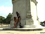 Slut licking mistress outdoor in public