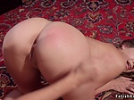 Brunette lesbian spanks lover in corset shop