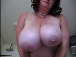 Big mature mom showing her huge breast