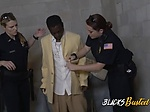 Two female police officers take a black guy to jail