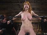 Busty sub set on a metal device bondage