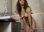 Teen Margaret Robbie cleans shaved pussy in the shower