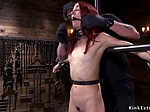 Skinny redhead slave whipped in device bondage