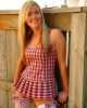 Outdoors striptease of nice blonde