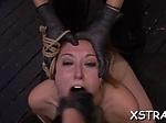 Punishing bondage for busty redhead...
