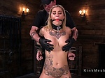 Tattooed blonde pussy rubbed in bondage