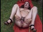 Dirty hairy grandma masturbating and pissing in the gar
