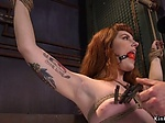 Gagged redhead doggy banged in bdsm threesome