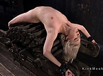 Blonde slave paddles in device bondage