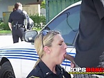 Horny milf cop sucks on criminals balls while the other